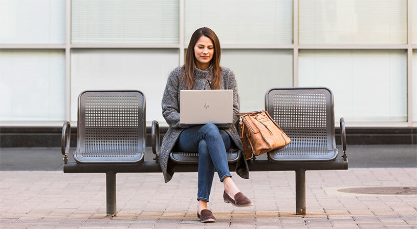 Woman looking at content on a laptop.