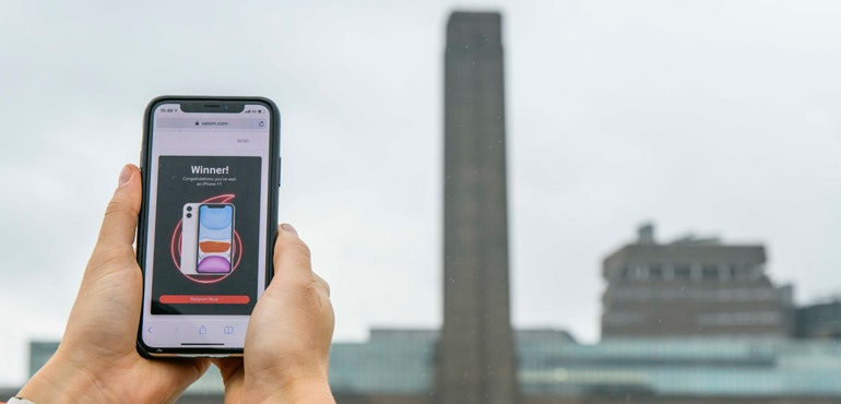 Vodafone Find Unlimited campaign on mobile phone in front of Trafalgar Square