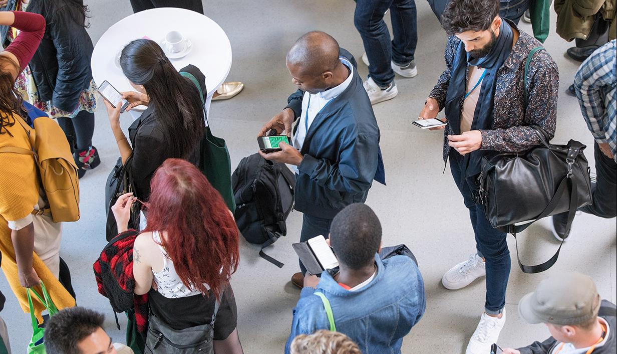 Group of people on mobile devices
