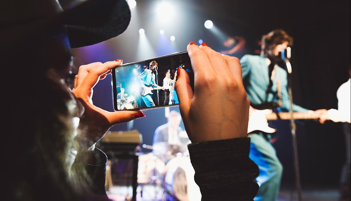 Women filming concert