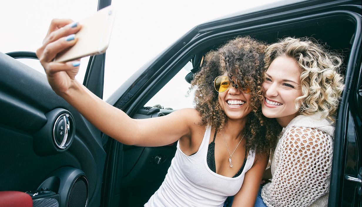 Two girls taking a selfie with mobile phone