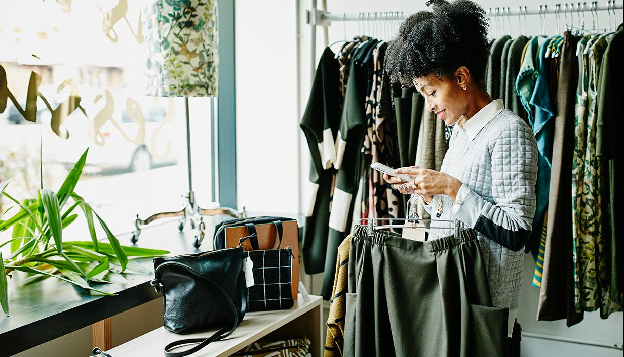 woman shopping and using her mobile