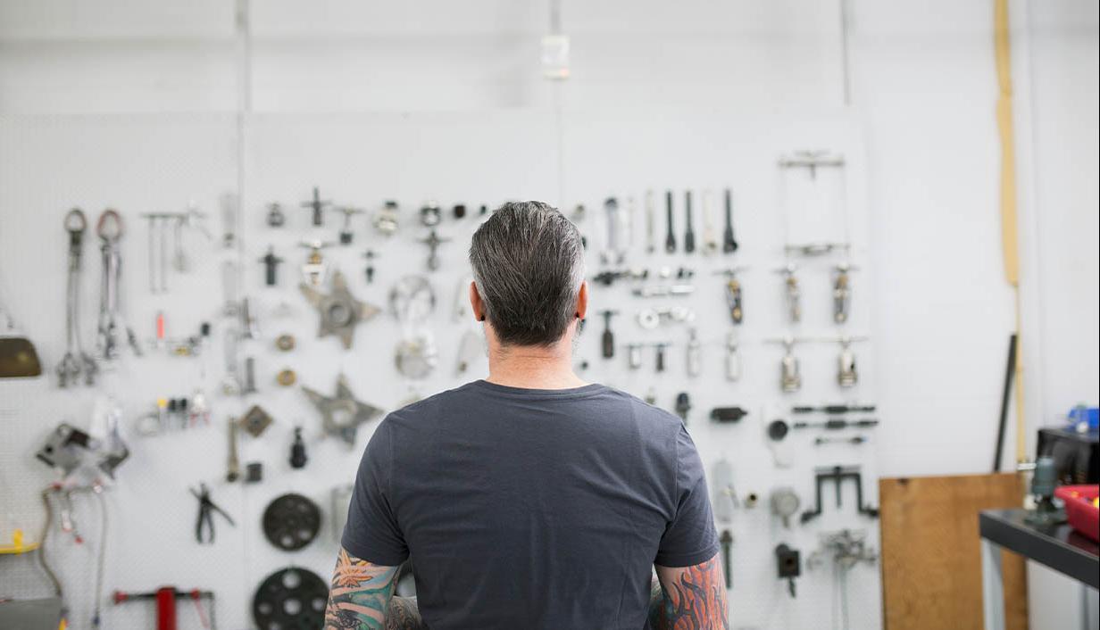Man looking at an idea board