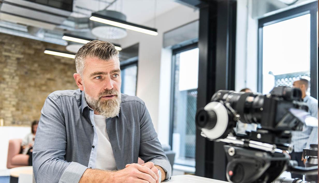 Man recdoring into a video camera