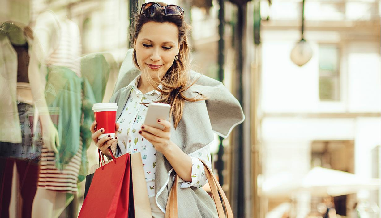 Female shopper with mobile phone