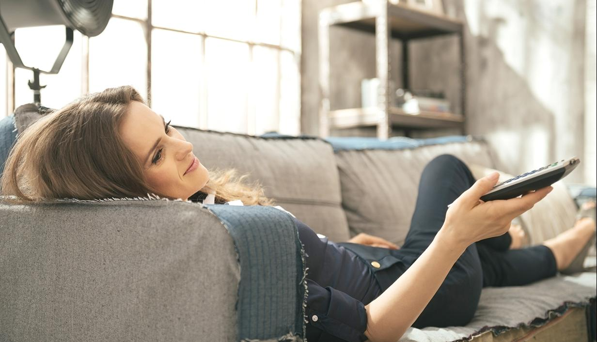 Woman on couch watching smart TV