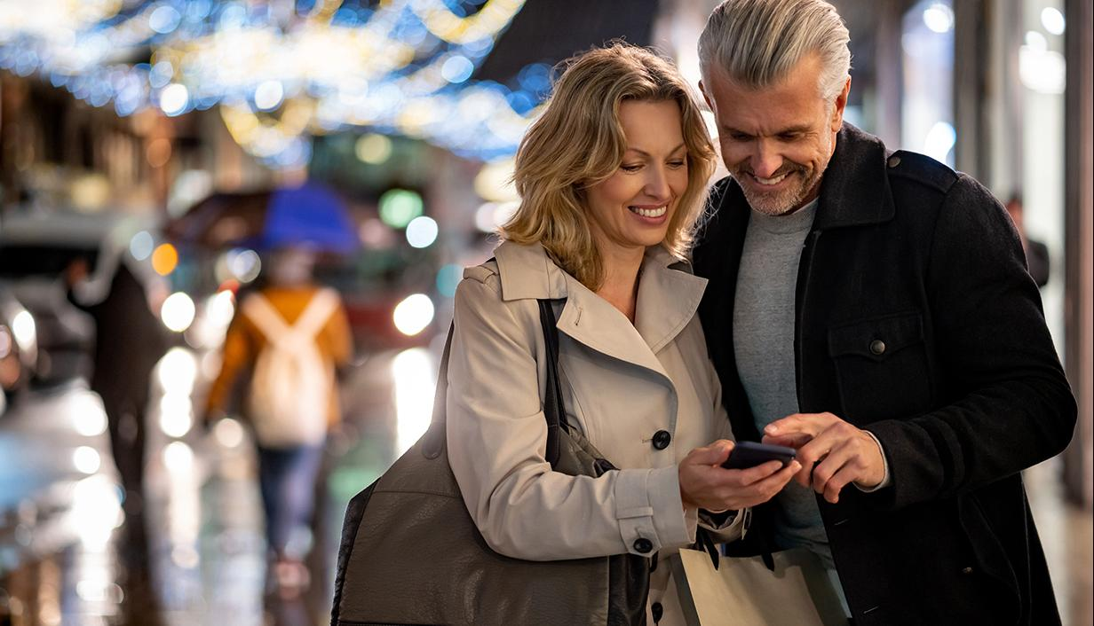 Couple shopping and looking at mobile phone