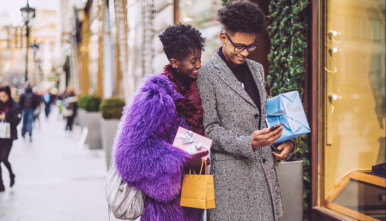 Couple holiday shopping using mobile phone