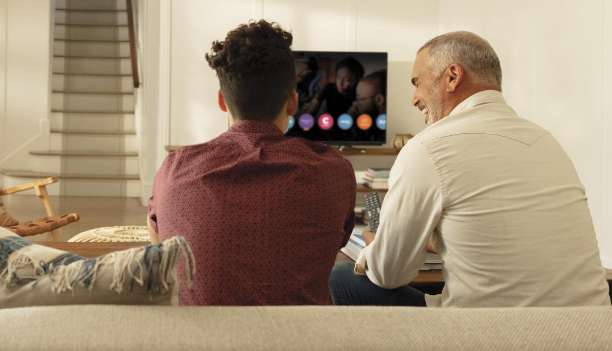 Younger man and older man watching TV