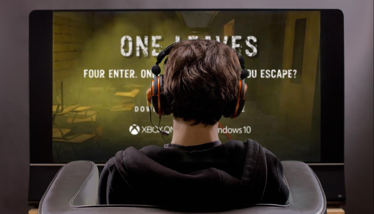 Boy with headphones playing video game