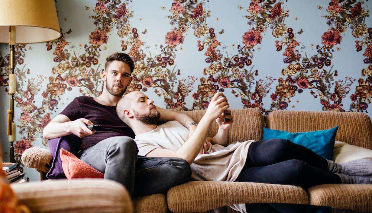 two men on a couch