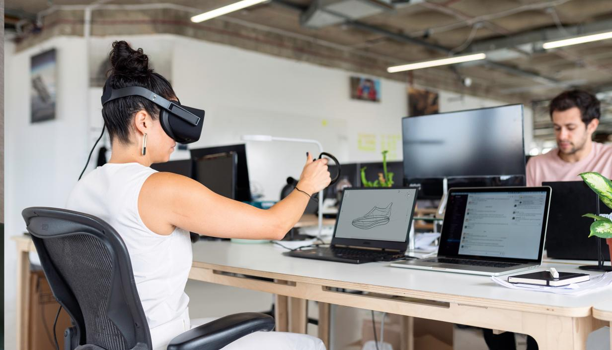 Woman working with a VR Glasses