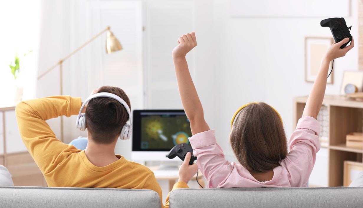 Man and woman playing gaming console
