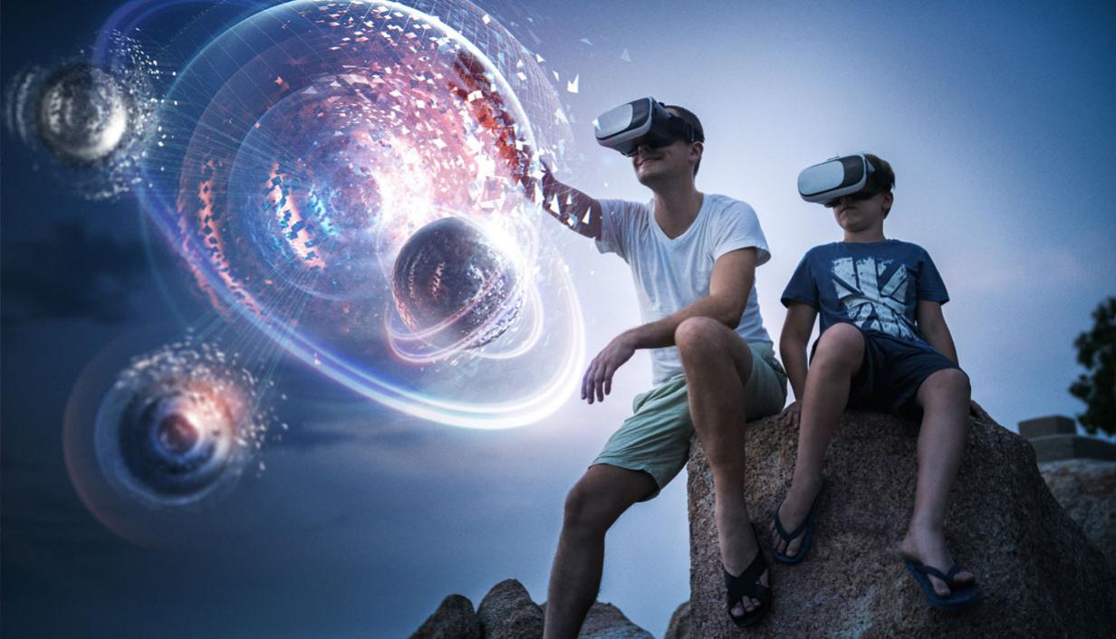 Two boys sitting on a boulder wearing virtual reality headsets and simulated image of space superimposed in the direction they are looking