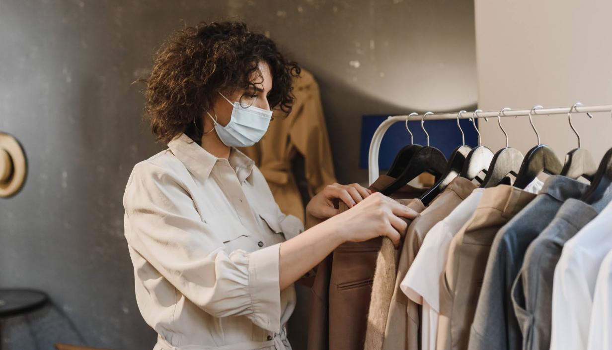 Woman in sore wearing a mask